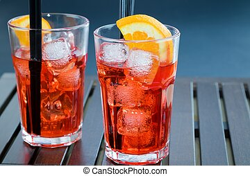 spritz aperitif aperol cocktail with two orange slices and...
