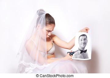 Bride scissor a photo which shows the groom - Bride scissor...