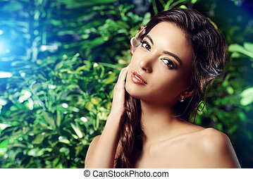 young skin - Beautiful young woman on a background of green...