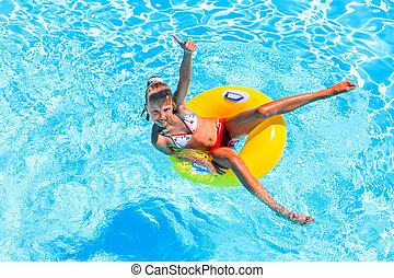Child swimming on inflatable beach mattress. - Little girl...