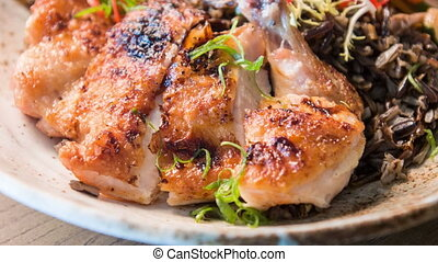 Prepared grilled chicken decorated with greenery -...