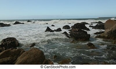 Atlantic ocean surf, splash over the stones.