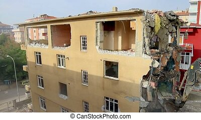 Destruction of building by excavato