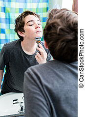 Teenager - Teenage boy getting ready for school in the...