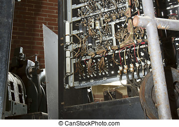 Old electrical panel and controls of aging elevator