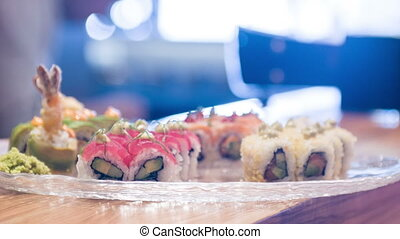 Selective focus on different delicious rolls lying in big...
