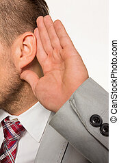 man listening to - a man business owner or manager holds his...