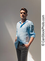 handsome casual man standing - Picture of a handsome casual...