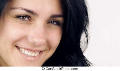 Woman smiling drying long hair