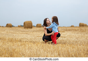 Mom and daughter in a field