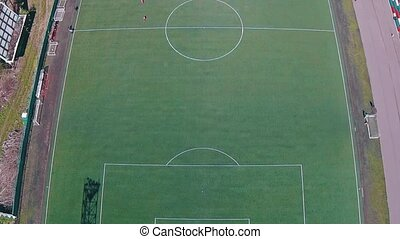 Aerial View of School Team Playing Football, sunny day