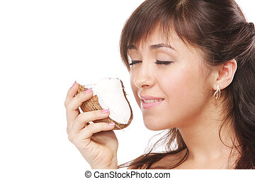 Brunette smelling coconut - Pretty young brunette woman...