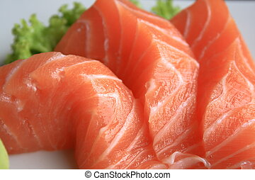 sashimi - three fresh pieces of salmon sashimi