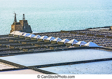 salinas de janubio in Lanzarote, Spain with salt piles