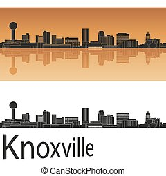 Knoxville skyline in orange background in editable vector...
