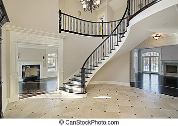 Foyer with spiral staircase - Foyer in new construction home...