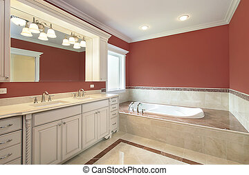 Master bath with salmon colored walls - Master bath in new...