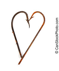 Old rusty fish hooks in form of heart