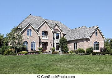 Luxury brick home with balcony