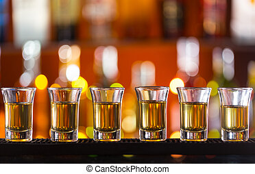 Variation of hard alcoholic shots on bar counter - Variation...