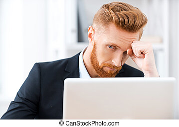 Failed again Frustrated bearded businessman working on...