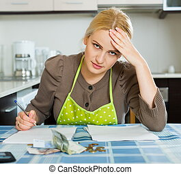 Blond housewife filling payments bills - Blond housewife...