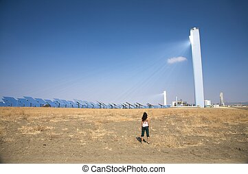 woman at solar power station - solar power station at...