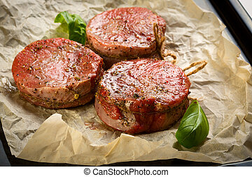 Medallions of Beef Fillet on paper for baking