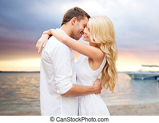happy couple hugging over sunset at summer beach - summer...