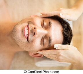 man in spa - healthcare, spa and beauty concept - man is...