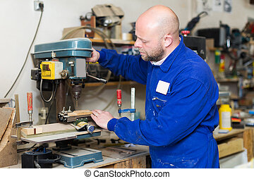 Woodworker on lathe in workroom - Portrait of serious adult...