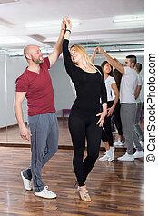 Couples enjoying of partner dance