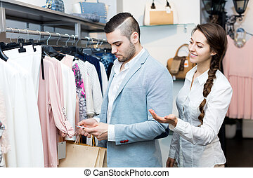 Shop girl helping client