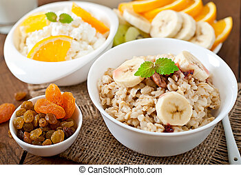 Healthy breakfast - oatmeal, cottage cheese, milk and fruit