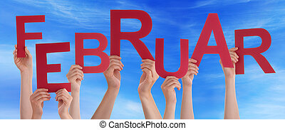 People Hold German Februar Means February Blue Sky - Many...