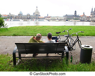 Dresden - Men travel on bicycles old town of Dresden,...