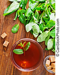 mint tea on the wooden table, fresh tea