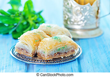 Baklava, Turkish dessert on metal plate and on a table