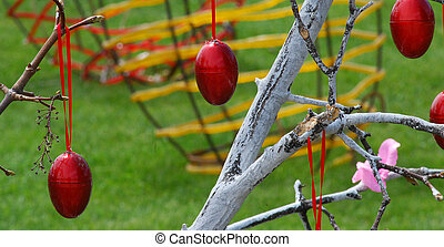 Red easter eggs on a tree