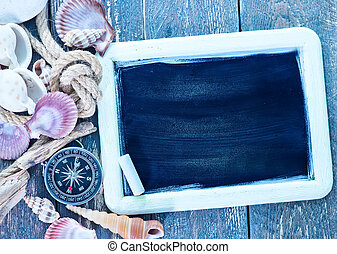 sea shells - background, sea shells and compass on a table