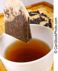 Tea cup and tea bag close up