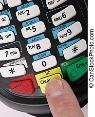 Payment terminal - Finger pressing a key on a Payment...