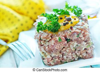 tar-tar - meat tar tar with yolk on the plate
