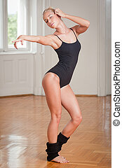 Feminine fitness - Young blond fitness beauty doing dance...