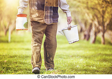 Farmer with milk bottles - Unrecognizable farmer with jug...
