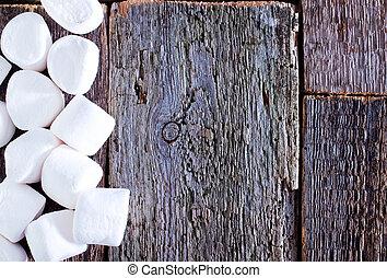 marshmallows - white marshmallows on the wooden table, fresh...