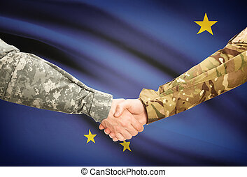 Military handshake and US state flag - Alaska - Soldiers...