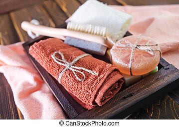 towels and soap - clear towels and aroma soap in the wooden...