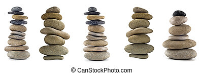 Collection of Balanced stone stacks or towers isolated over...