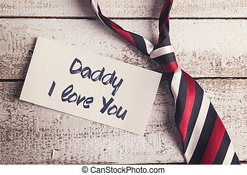 Fathers day composition - Daddy I love you sign on paper and...